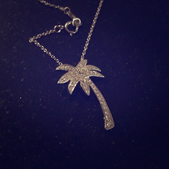 f42260f65 Authentic Tiffany & Co. platinum palm tree pendant.  M_5b50f36142aa76e1a379b887. Other Jewelry you may like. Tiffany's Necklace